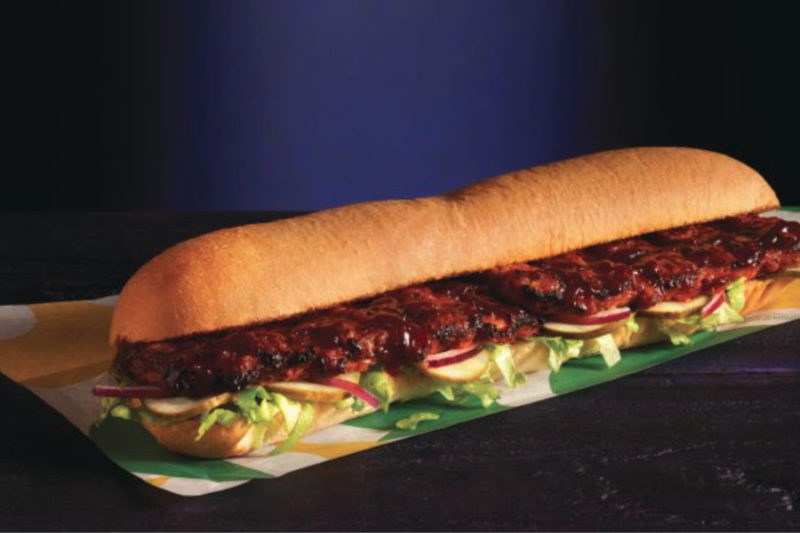 New from Subway is the BBQ Rib Sandwich, featuring rib-shaped pork patties topped with sweet barbecue sauce, lettuce, onions and pickles on Italian bread.