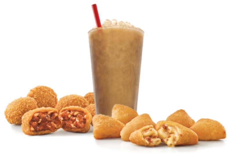 Cheese is in the spotlight at Sonic, which is adding two new cheesy options to its lineup. The Chili Cheese Bites are a bite-size version of Sonic's chili with cheese in a crispy corn chip coating, while the Bacon Mac & Cheese Bites are made with macaroni and cheese blended with bacon pieces and coated in a light, crispy batter.  Additionally, Sonic is serving new Cold Brew Iced Coffee in original and vanilla flavors. The beverages include a touch of sweet cream.