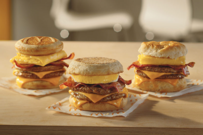 """McDonald's is launching its first breakfast menu innovation since 2013. Triple Breakfast Stacks feature two slices of American cheese between two sausage patties, topped with bacon and an egg and served on an English muffin, biscuit or McGriddles cakes. The inspiration for the product came from a """"Secret Menu"""" of customized orders submitted online, according to the company."""