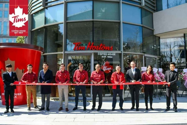 Tim Hortons opens its first restaurant in China.