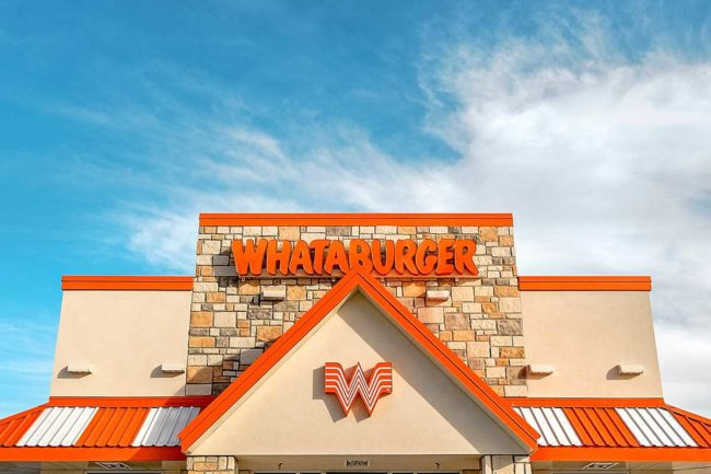 Exterior photo of Whataburger logo on restaurant.