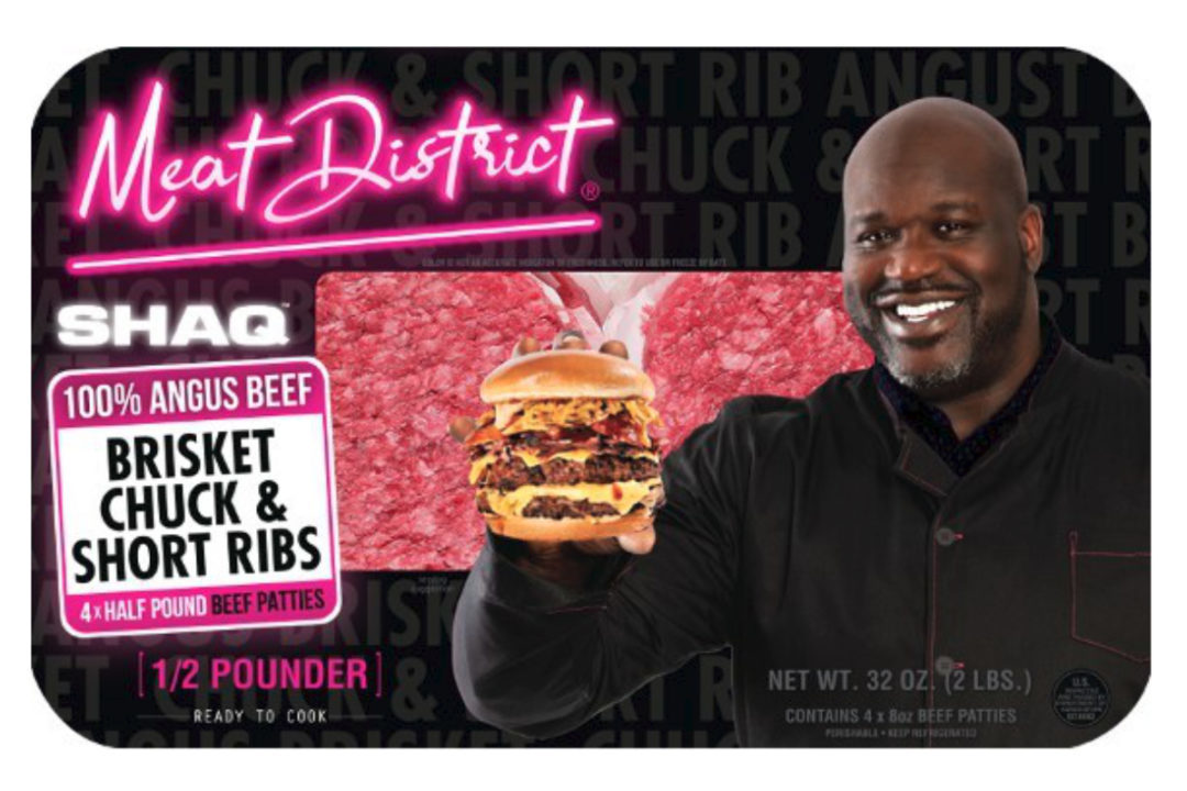 Shaquille O'Neal holding a Shaq Burger