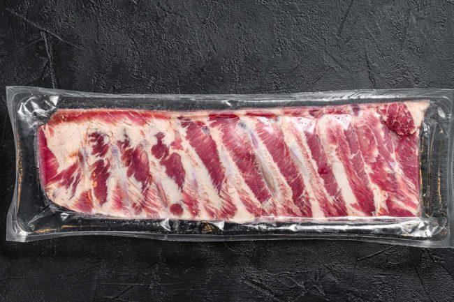 Rack of ribs in clear plastic packaging