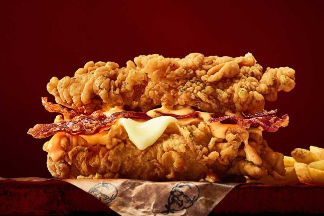 Double Down chicken sandwich with bacon, cheese and sauce, served between two breaded fried chicken fillets