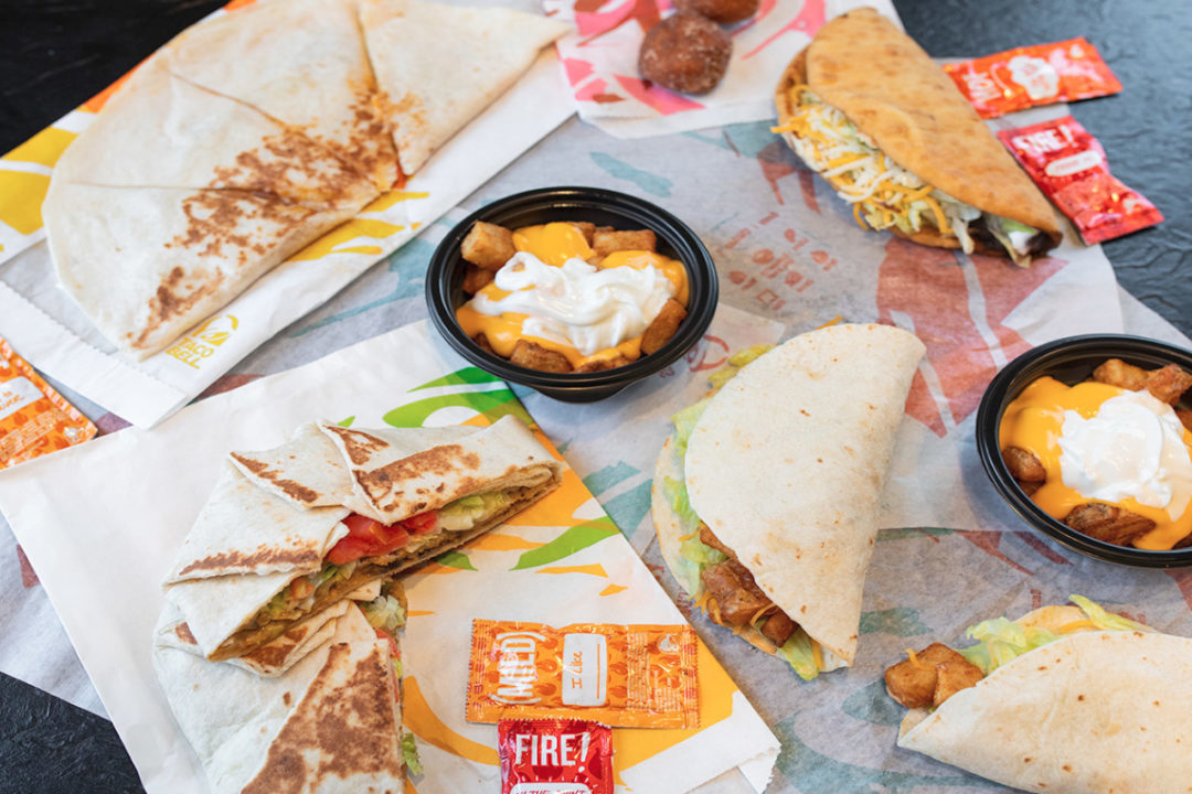 Taco Bell is considering adding plant-based protein options from Beyond Meat.