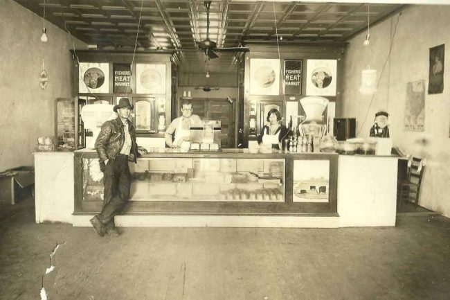 Albert Andress, Joe Fisher and Gerlie Fisher at the original shop in 1932.