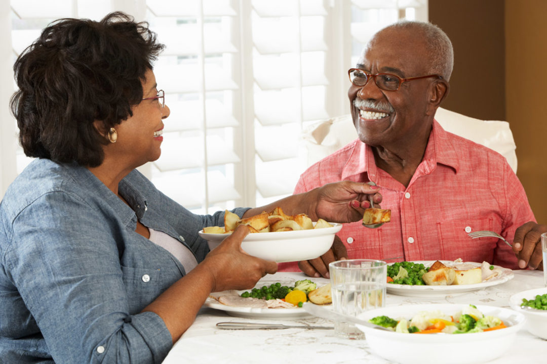 African-American couple having dinner