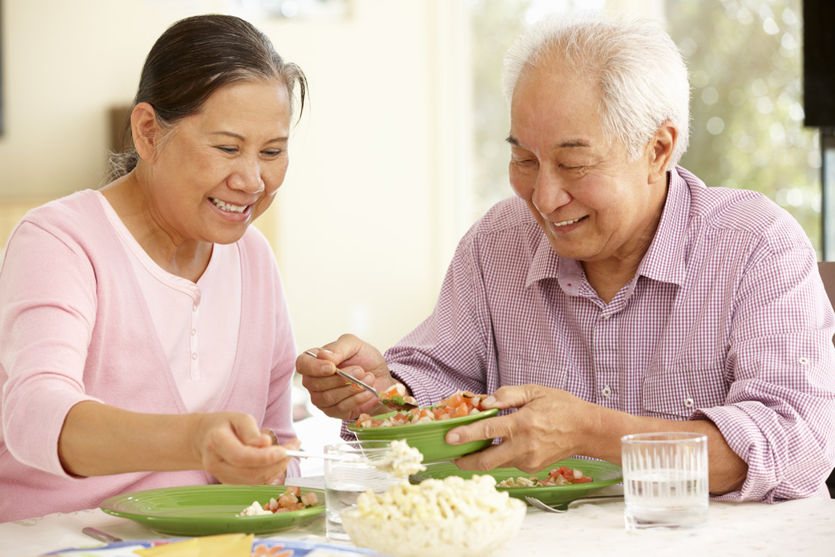 Asian couple dining at home