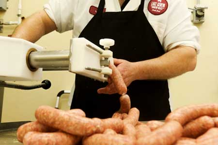 Jeff Schmalfeldt, plant manager at Lake Geneva Country Meats, mans the bratwurst stuffer.