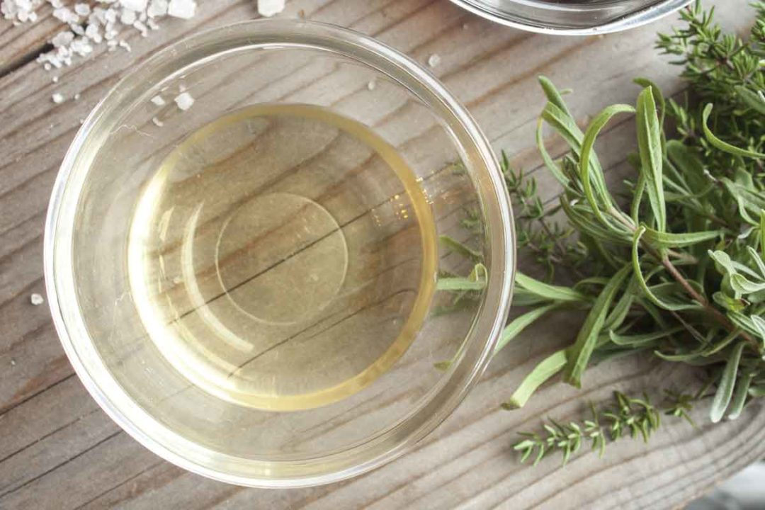 bowl of vinegar and sprigs of fresh rosemary.jpg