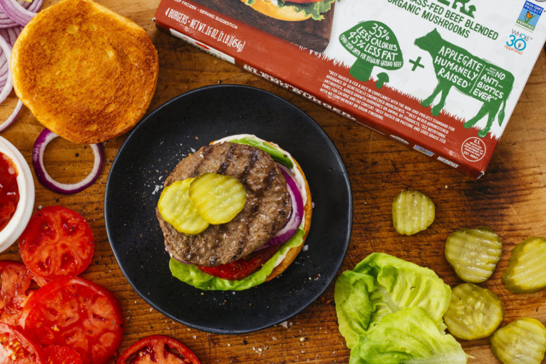 Applegate burger patty topped with pickles