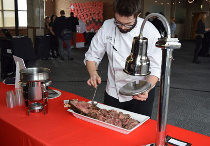 Chef serving prime rib au jus flavored with Tabasco