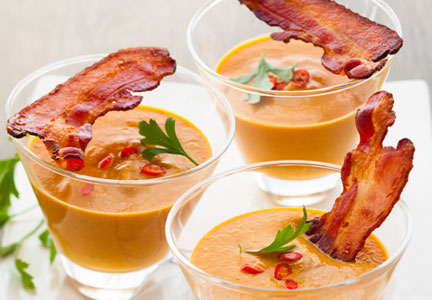 Bacon garnish on soup appetizer