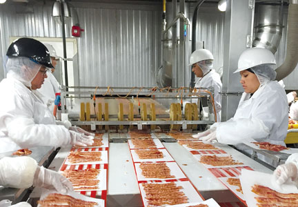 Sugar Creek's Frontenac, Kan. plant employs 544 workers and produces 40 million lbs. of raw, sliced bacon each year.