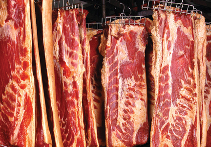 Stocks of pork bellies in freezers plunged compared to a year ago.