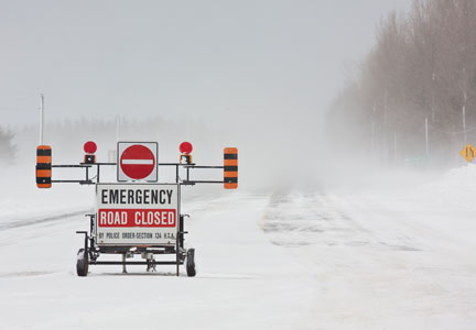 Blizzard conditions force some meat processors to close plants.