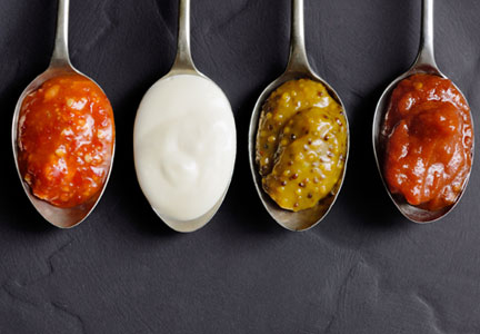 condiments on spoons