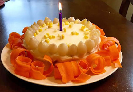 meatloaf birthday cake topped with a candle