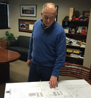 Tim Fallon, president and CEO of Columbus Foods, looks over floorplans for a new meat plant in Hayward California