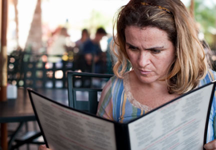 Woman reading a restaurant menu