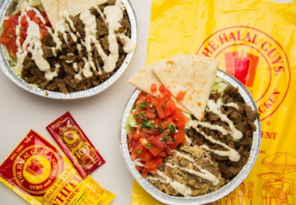 The Halal Guys are known for generous servings of Middle Eastern foods topped with white and hot sauces.