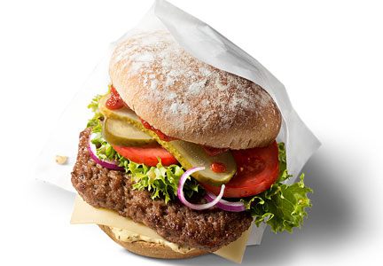 McDonald's Germany's McB combines an organic beef patty with lettuce, tomatoes, pickles, red onion rings, Edam cheese, various sauces and dark bread.