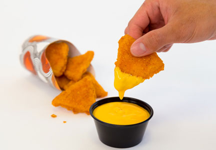 Naked Chicken Chips and dipping sauce from Taco Bell