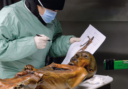 Otzi, a 5,300-year-old ice mummy, undergoes scientific evaluation.