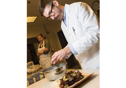 Jason Ball, a research chef at the Food Innovation Center in Portland, prepares dishes made with dulse to be taste-tested by the general public. (Photo by Stephen Ward.)