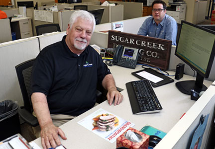 SugarCreek CEO John G. Richardson and his son, Michael, run the company from cubicles and not corner offices.