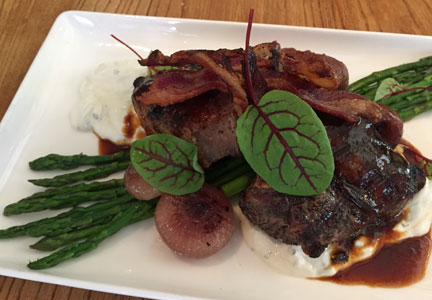 Bastille Kitchen features Superior Farms lamb chops topped with lamb bacon.