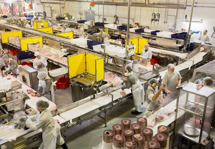 Employees work pork processing lines at Swickers Kingaroy Bacon Plant