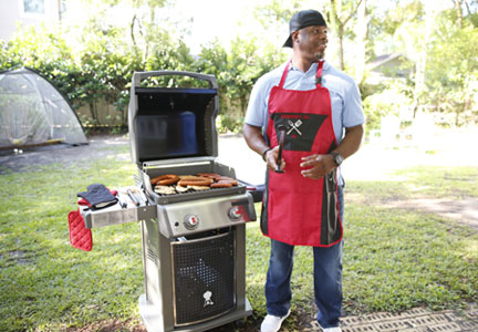 Former MLB player Ken Griffey, Jr. stands ready at the grill as part of Tyson Foods' Legends at the Grill video series.
