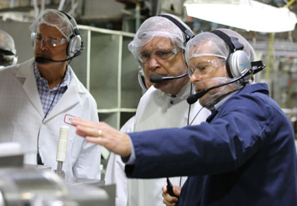 Foster Farms CEO Ron Foster, Secretary Vilsack and Foster Farms Vice President of Operations Chris Carter during a tour of the company's plant.